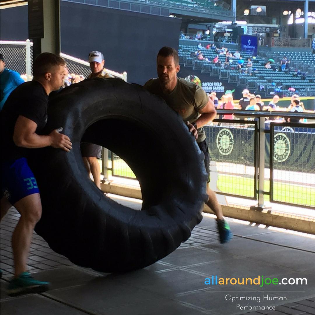 Doing a few tire flips with Kurt Garceau at the Battle of the Ballpark